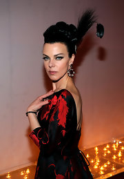 Actress Debi Mazar isn't seen too often, but when she does make an appearance she makes sure that everyone knows. She showed off this over-the-top up-do with an added feather.