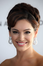 Kelly's braided updo adds a fairytale flavor to her evening look and shows of her elegant diamond earrings.