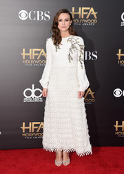 Keira Knightley completed her red carpet look with silver web sandals by Rupert Sanderson.