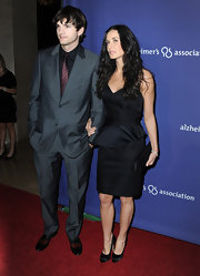 Demi sported an elegant pair of black satin pumps to complete her all black evening ensemble.