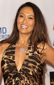 At the Race to Erase MS gala, Tia Carrere wore her long hair in a side part with just the slightest hint of a wave at the ends.