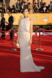 Funny gal Kristen Wiig actually takes fashion very seriously, and she's always dressed to impress, and on this occasion she did so in this drop-waist Balenciaga gown. The soft color let the dazzling choker make the most dramatic statement.