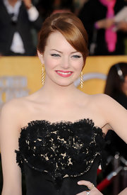 Emma Stone wore her hair in a sleek updo with sweet side-swept bangs at the 18th Annual SAG Awards.