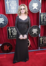 At the 2012 SAG Awards, Jessica sparkled in a custom espresso sequined long sleeve evening gown.