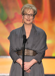 Meryl Streep attended the 18th Annual SAG Awards wearing a pair of 1920s carved citrine and sapphire pendant earrings.