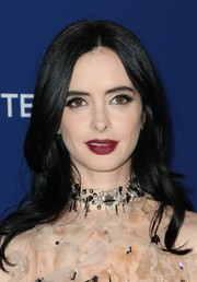 Krysten Ritter coated her lips a dark red hue for a sexy beauty look.