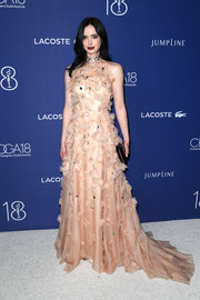 Krysten Ritter looked enchanting in a petal-appliqued peach halter gown by Lela Rose at the Costume Designers Guild Awards.