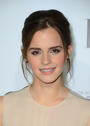 Emma Watson tucked her hair into a slightly messy updo for the 'Elle' celebration.