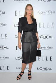 Uma Thurman tied her tailored look together with a skinny black leather belt.