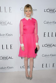 Emma Stone was picture perfect in this hot pink collared dress at the Elle Women in Hollywood Celebration. (Psst! Check out those shoes.)