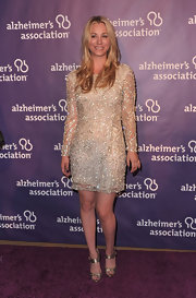 Kaley Cuoco added shine to her glam look with shimmering gold ankle strap heels.