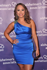 Cheryl Burke paired her vibrant blue dress with a glittery purple clutch.