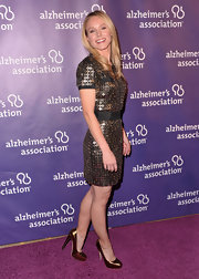 Kristen Bell added high octane shine to her fundraiser attire with metallic copper Maniac platforms.