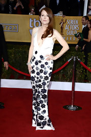 Julianne Moore took the plunge in this gorgeous white satin column dress with navy floral appliques.