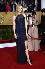 Nicole Kidman looked decadently gorgeous in this sheer midnight blue beaded gown with a thigh-high slit.