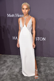 Zoe Kravitz complemented her dress with silver ankle-tie sandals, also by Atelier Versace.