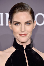 Hilary Rhoda topped off her look with a neatly gelled updo when she attended the amfAR New York Gala.