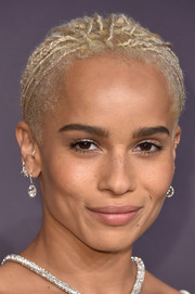 Zoe Kravitz attended the amfAR New York Gala wearing her signature tiny braids in an updo.