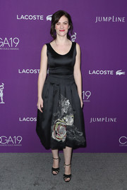Maggie Siff attended the Costume Designers Guild Awards wearing a little black dress with a flower-embellished skirt.