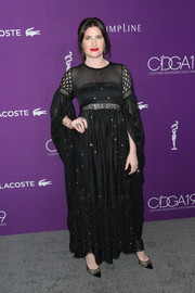 Kathryn Hahn went for boho glamour in a black mesh-panel gown at the Costume Designers Guild Awards.