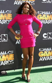 Venus Williams paired her hot pink sheath dress with black studded peep toes.