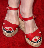 Frances Fisher looked ready for summer in her red cross-strap sandals with raffia wedge heels.