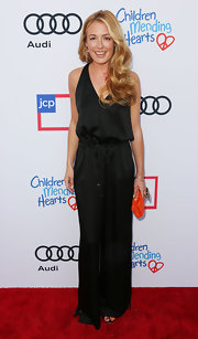 Cat Deeley looked sultry in a black silk jumpsuit at the Children Mending Hearts Style Sunday.