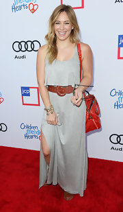 Hilary Duff looked laid-back in a sleeveless gray maxi dress at the Children Mending Hearts Style Sunday.