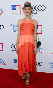 Angela Lindvall looked vibrant on the Children Mending Hearts red carpet in a sleeveless orange and peach dress.