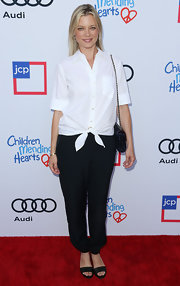 Amy Smart paired black slacks with a white button-down for a simple yet classic look during the Children Mending Hearts Style Sunday.