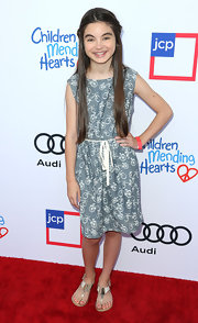 Landry Bender wore silver thong sandals with her casual dress for a bit of shimmer.