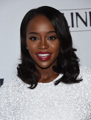 Aja Naomi King opted for a classic side-parted 'do with curly ends when she attended the Marie Claire Young Women's Honors.