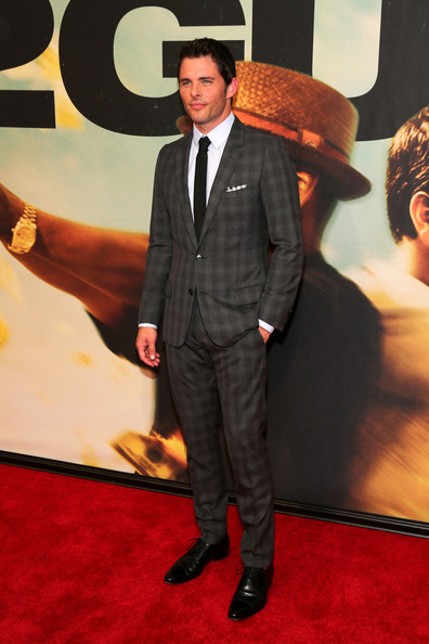 James looked completely dapper in a gray plaid suit and a black skinny tie.