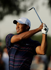 Tiger promotes Nike with this white baseball cap.