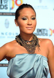 Adrienne Bailon highlighted her bare neckline with a chain embellished necklace.