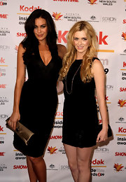 Megan Gale complemented her LBD with a gold satin clutch for a totally elegant look during the 2009 Inside Film Awards.