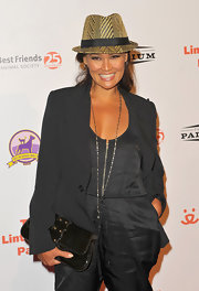 Tia Carrere accessorized with a studded black leather clutch at the 2009 Lint Roller Party.