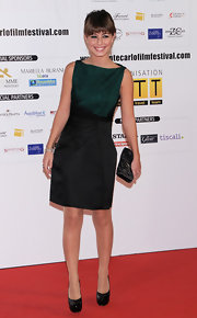 Alessandra Mastronardi paired an ultra chic structured black skirt with her green top for a totally elegant look.