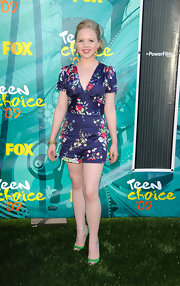 Sofia looked retro chic in a fitted floral romper. Bright green heels are a fun addition to the look.