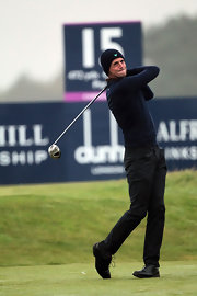 Matthew hits the green in a navy blue knit beanie.