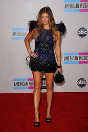 Fergie chose a satin crocheted clutch for the AMAs. The bag features a wrist strap and Asian-influenced details.