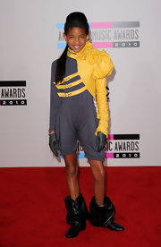 Willow Smith showed off another cutting edge look in a navy turtleneck romper. A decorative yellow sleeve with buckles and an exaggerated shoulder complete Willow's fashion forward look.