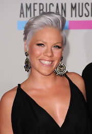 Pink was all smiles on the red carpet of the American Music Awards. The newly expecting mom paired her silver tresses with diamond earrings.