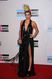 The always outlandish Kesha donned a black halter dress embellished with long strips of video tape. A faux hawk and over the top metallic makeup complete the look.