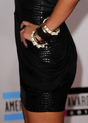 Singer Keri Hilson spiced up her textured black dress with an arm full gold and black bangle bracelets.