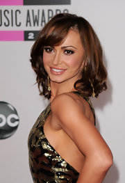 Karina Smirnoff rocked brunette curls with side-swept bangs while attending the American Music Awards. Her look was completed with peach lip gloss.