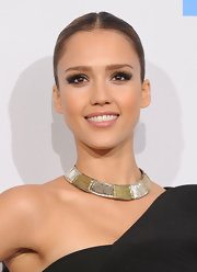 Jessica Alba perfectly complemented her one-shoulder dress with a gold and silver collar necklace. A perfect match for her sleek ponytail.