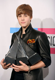 Justin paired his sleek leather jacket with a simple beaded bracelet.