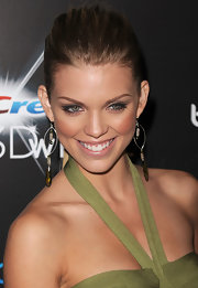 AnnaLynne McCord showed off her gold dangle earrings, which were accented with green crystals.