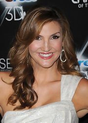 Heather wore long, side-parted curls with dangling diamond earrings and dark lashes.